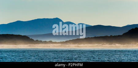 Ocean in Van Dyks Bay at sunrise, Western Cape Province, South Africa - Stock Photo