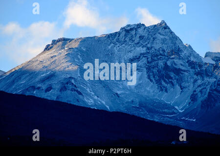 One of the Martial mountains that surround Ushuaia seemingly has a blue colour. It received little snow that slightly changed its colour. - Stock Photo