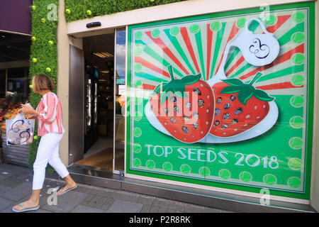 London UK. 16th June 2018.  Wimbledon: Shopkeepers  in Wimbledon High Street  decorate their shop fronts in tennis themes as part of the annual tennis window display competition - Stock Photo