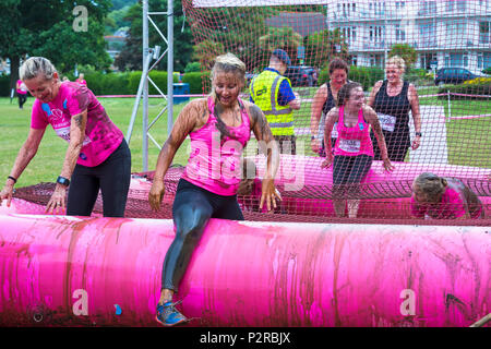 Baiter Park, Poole, Dorset, UK. 16th June 2018. Hundreds of women take part in Pretty Muddy Race for Life to raise money for Cancer Research UK over an obstacle course over 5km and have fun getting covered in mud. Credit: Carolyn Jenkins/Alamy Live News - Stock Photo