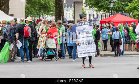 Whitehall, London, UK; 16th June 2018; Justice for Grenfell March and Rally, One Year On Credit: Ian Stewart/Alamy Live News - Stock Photo