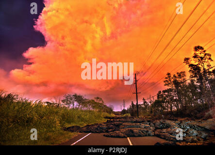 Pahoa, Hawaii, USA. 6th June, 2018. Lava covers access below on Hwy 132 with the evening sky taking on a brilliant hue from chemicals emitted by the lower east rift zone eruption on Wednesday, June 6, 2018, in Pahoa, Hawaii. Photo by L.E. Baskow/LeftEyeImages Credit: L.E. Baskow/ZUMA Wire/Alamy Live News - Stock Photo