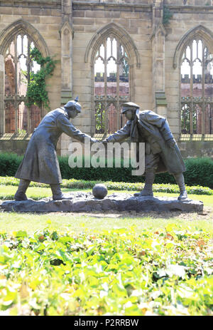 All Together Now, sculpture representing the 1914 Christmas Day Truce in WW2, outside the Bombed Out Church, in Liverpool, on Merseyside, UK - Stock Photo