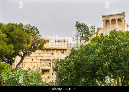 Temple of Athena Nike Propylaea Ancient Entrance Gateway Olive Trees Ruins Acropolis Athens Greece Construction ended in 432 BC Temple built 420 BC.   - Stock Photo