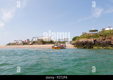 Tenby, UK: June 11, 2018: Tour boat collects passengers to explore the Pembrokeshire coastline and see the wildlife including puffins and seal safari - Stock Photo