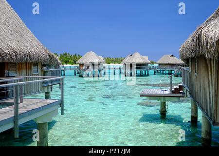 France, French Polynesia, Society Islands, Windward Islands, Moorea, Overwater bungalows of Sofitel hotel - Stock Photo