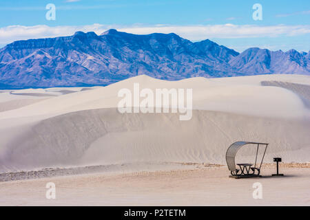 Picnic tables on Sand dunes at White Sands  National Monument in New Mexico on a cold morning in February. - Stock Photo