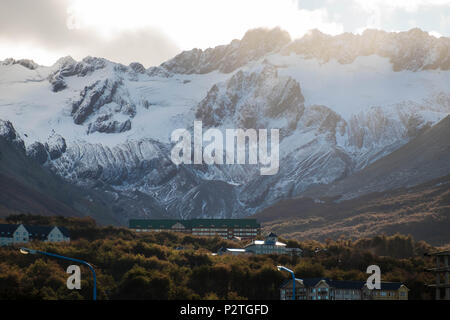 The Martial glacier looks out over the city of Ushuaia in Tierra del Fuego. In the forest, a big hotel is built and lies close to the hiking trail. - Stock Photo