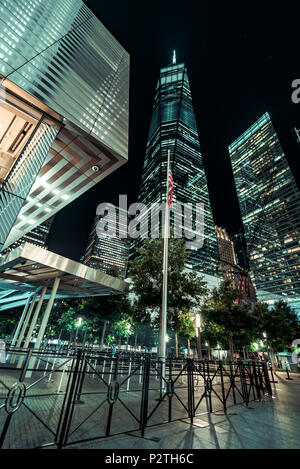 Lower Manhattan/Financial District  at Night; 9/11 memorial park and Freedom Tower - Stock Photo
