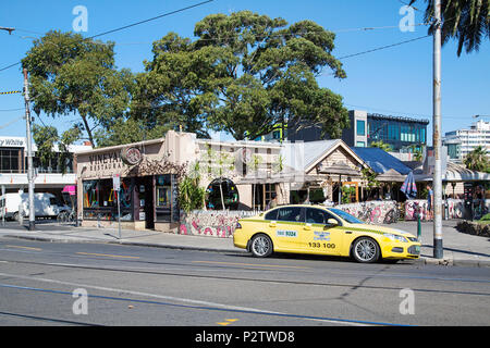Melbourne, Australia: April 13, 2018: The Vineyard Bar and Restaurant in Acland Street, St Kilda is very popular with tourists for a refreshing drink. - Stock Photo