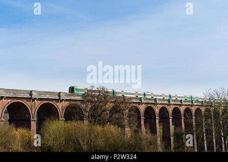 A Southern train passing over the Ouse Valley Viaduct near Haywards Heath West Sussex, England, UK on the London to Brighton line - Stock Photo