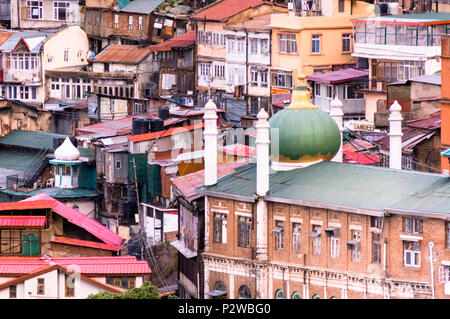 Mosque shot against smaller buildings in shimla  - Stock Photo