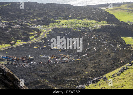 View over the remains of the old fish factory destroyed in the 1961 eruption at Tristan da Cunha, British Overseas Territories, South Atlantic Ocean - Stock Photo