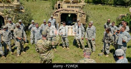 Brig. Gen. William Edwards, the Oregon Army National Guard's land component commander, speaks with Soldiers from Bravo Company, 3rd Battalion, 116th Cavalry Brigade Combat Team, during exercise Saber Guardian 2016, August 5, at the Romanian Land Forces Combat Training Center in Cincu, Romania. Saber Guardian is a multinational military exercise involving approximately 2,800 military personnel from ten nations including Armenia, Azerbaijan, Bulgaria, Canada, Georgia, Moldova, Poland, Romania, Ukraine and the U.S. The objectives of this exercise are to build multinational, regional and joint par - Stock Photo