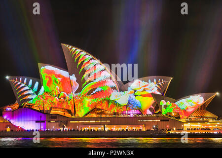 Sydney, Australia - 25 May, 2018: Sydney city landmark of Sydney Opera House at harbour waterfront during annual light show of light and ideas in brig - Stock Photo