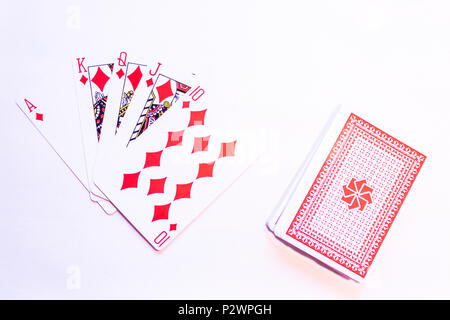 Playing Cards with the winning hand of a Royal Flush in Poker with Diamonds - Red Pack - Stock Photo