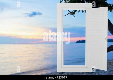 White window open frame with sunset beach, horizontal landscape idea concept background. - Stock Photo