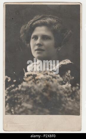 THE CZECHOSLOVAK  REPUBLIC - CIRCA 1930s: Vintage photo shows a young woman - Edwardian hairstyle. Retro black & white  photography. - Stock Photo