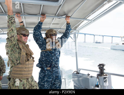 160806-N-HI414-038 San Diego, Calif. (August 6, 2016) Capt. Joaquin Martinez (left), Commanding Officer of Coastal Riverine Squadron (CORIVRON) 1, discusses the technology and capabilities of CORIVRON 1 with Rear Adm. Eric Young, Commander, Navy Reserve Forces Command. While aboard Navy Operational Support Center North Island, Young also visited tenant commands to brief on status of the force. (U.S. Navy photo by Mass Communication Specialist 2nd Class Gregory A. Harden II/Released)