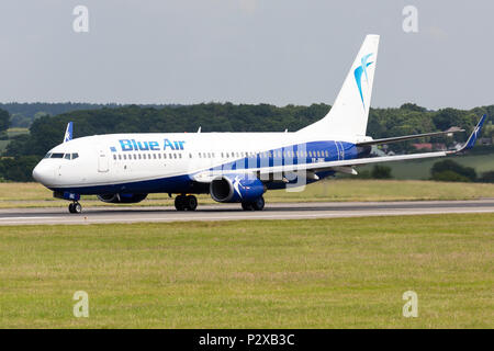 A Blue Air of Romania Boeing 737 commercial jet airliner, at London Luton Airport in England. - Stock Photo