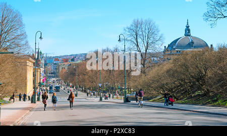 OSLO, NORWAY - APRIL 12, 2010: Street Karl Johans gate in the center of capital. It is a main street of the city. Young people near University of Oslo - Stock Photo