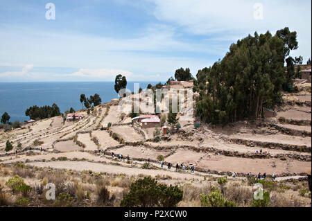 The public path leads to the village at the very top of the hill on Taquile Island, Puno, Peru, South America - Stock Photo