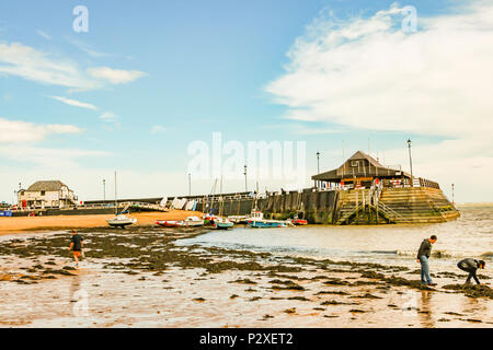 boys having fun on the water's edge on the beach at viking bay, broadstairs, kent, england - Stock Photo