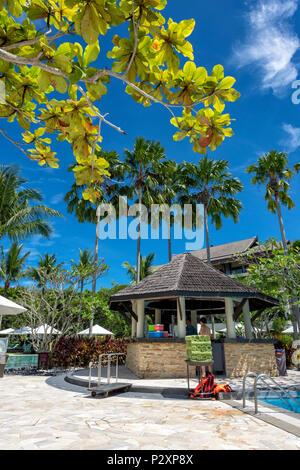 Sunbeds and Parasol on a white sand beach at the Shangri La Rasa Ria Hotel and Resort in Kota Kinabalu, Borneo, Malaysia - Stock Photo