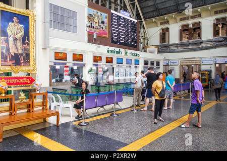 Bangkok, Thailand-19th March 2018: Passengers queuing for tickets, Hua Lamphong station. This is the main railway station. - Stock Photo