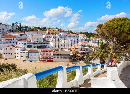 Stairs leading to the sandy beach surrounded by typical white houses,  Carvoeiro, Algarve, Portugal. - Stock Photo