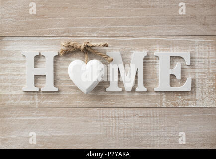 Home sweet home, wooden text on vintage board background with copy space - Stock Photo