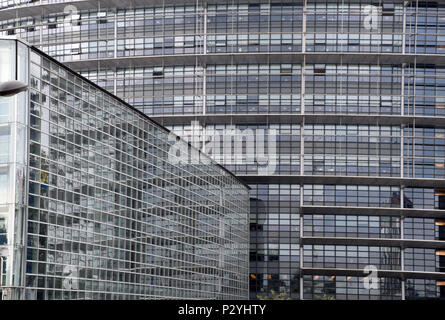 STRASBOURG, BR, FRANCE - JUNE 13, 2018: European Parliament in Strasbourg under overcast sky, big glass facade of the Parliament of the EU - Stock Photo