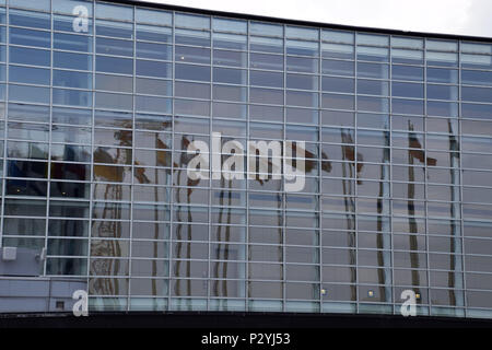 STRASBOURG, BR, FRANCE - JUNE 13, 2018: glass facade of the European Parliament in Strasbourg with reflections of the flags in the windows - Stock Photo