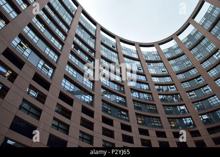 STRASBOURG, BR, FRANCE - JUNE 13, 2018: Dark clouds over the European Parliament Building in strasbourg with the windows of the members, - Stock Photo