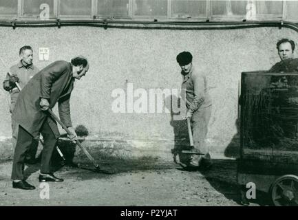 THE CZECHOSLOVAK  SOCIALIST REPUBLIC - CIRCA 1970s:  Retro photo shows workers cleaning the factory unit. Vintage  photography. - Stock Photo