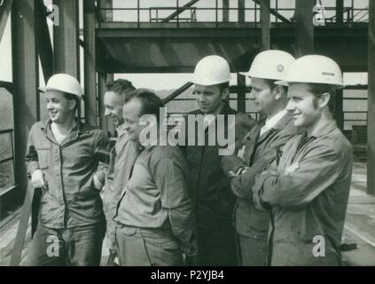 THE CZECHOSLOVAK  SOCIALIST REPUBLIC - CIRCA 1970s: Retro photo shows construction workers. Vintage  photography. - Stock Photo