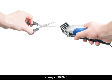 Man holds in one hand hairdressing scissors and in another clipper with a nozzle, isolated on a white background, first-person view - Stock Photo