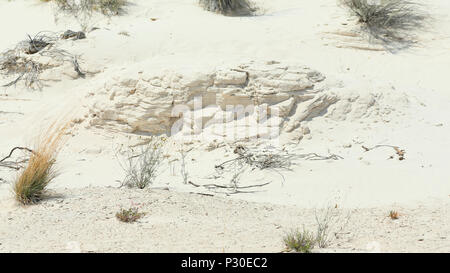 Wind sculpted sand layers in a gypsum sand desert near Las Cruces, New Mexico - Stock Photo