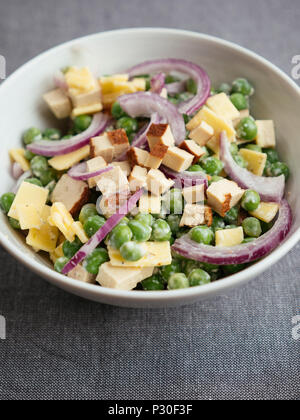 Vegan pea salad with tofu and vegan cheese - Stock Photo