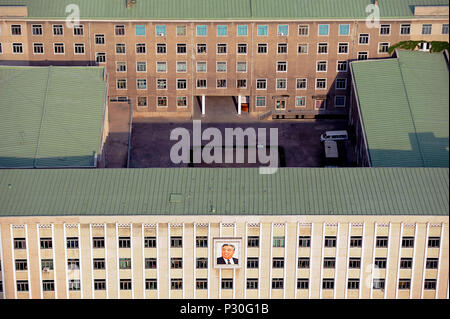 Pyongyang, North Korea, office building with image of Kim Il-Sung on the facade - Stock Photo