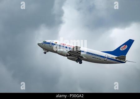 2018.06.15, Minsk, Belarus, National Airport - Plane in the stirmy sky - Stock Photo