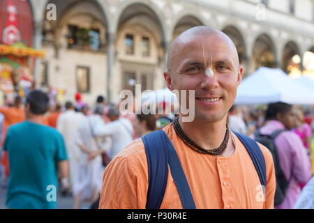 An happy Hare Krisna monk smiles with devotion and compassion - Stock Photo