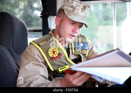 Twinsburg, Ohio – Cpl. Eric A. Fox a rifleman with the reaction platoon and bus driver for Initial Response Force B, or IRF B, with Chemical Biological Incident Response Force, CBIRF, reviews the given route book during a deployment drill in preparation for the Republican National Convention, RNC, in Cleveland, July 17, 2016.  CBIRF's Marines and sailors worked alongside federal and local agencies to provide chemical, biological, radiological, nuclear and high-yield explosives, CBRNE, response capability for the Republican and Democratic National Conventions.  CBIRF is an active duty Marine Co - Stock Photo