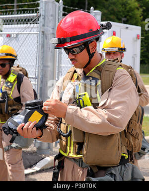 Twinsburg, Ohio. – Sgt. Alfred Eldredge, a motor vehicle operator with Chemical Biological Incident Response Force, CBIRF, inspects his M53 gas mask for any damages in preparation for the Republican National Convention, RNC, in Cleveland, July 18, 2016.  CBIRF's Marines and sailors worked alongside federal and local agencies to provide chemical, biological, radiological, nuclear and high-yield explosives, CBRNE, response capability for the Republican and Democratic National Conventions.  CBIRF is an active duty Marine Corps unit that, when directed, forward-deploys and/or responds with minimal - Stock Photo