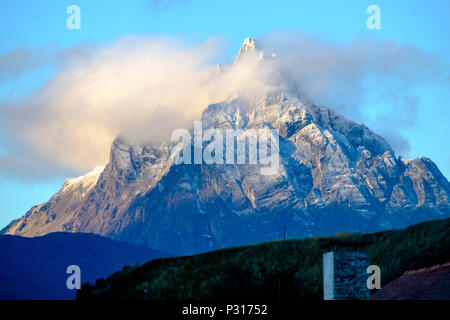 Monte Olivia is looking down on the city of Ushuaia. This sharp-headed mountain is the highest and most impressive one of Ushuaia. - Stock Photo