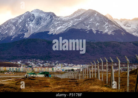 The Martial mountains, with the Martial Glacier at the extreme right, look out over the city of Ushuaia. The forest shows the colors of the autumn. - Stock Photo