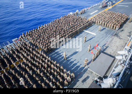 ABOARD USS BONHOMME RICHARD (LHD-6), At Sea (Aug. 22, 2016) - U.S. Marine Corps Col. Tye R. Wallace, the commanding officer of the 31st Marine Expeditionary Unit, III Marine Expeditionary Force, addresses the Marines and Sailors assigned to the 31st MEU after setting sail aboard the USS Bonhomme Richard (LHD-6), Aug. 22, 2016.   The 31st MEU is currently underway on board the ships of the USS Bonhomme Richard Amphibious Ready Group  The 31st MEU is the Marine Corps' only continuously forward-deployed Marine Air-Ground Task Force, and combines air-ground-logistics into a single team capable of  - Stock Photo