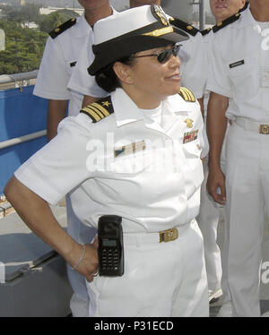 Bay, Republic of the Philippines (Apr. 24, 2004) - Lt. Cmdr. Romelda Sadiarin gives a tour of USS Coronado (AGF 11) to students from the Philippine Navy's Naval Education and Training Command. Coronado arrived for a scheduled port visit. The port visit gives the more than 450 Sailors, civilian mariners and Seventh Fleet staff members embarked aboard Coronado a chance to experience the unique culture of the Philippines, sightsee, and participate in community service projects.  The ship is serving as the temporary command ship for - Stock Photo