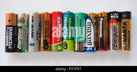 BERLIN, GERMANY - CIRCA MAY 2018: AA batteries of many different brands including GP Duracell Energizer Ansmann Uniross Maxell Panasonic Varta - Stock Photo