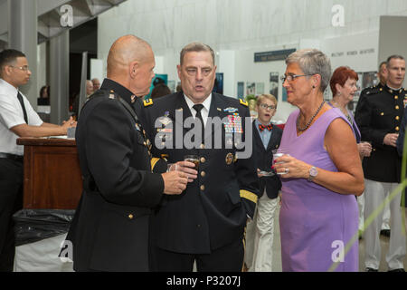 Commandant of the Marine Corps, Gen. Robert B. Neller, left, and his wife, D'Arcy Neller, right, speak to Chief of Staff of the Army, Gen. Mark A. Milley, during a sunset parade reception at the Women in Military Service for America Memorial, Arlington, Va., Aug. 9, 2016. Sunset parades are held as a means of honoring senior officials, distinguished citizens and supporters of the Marine Corps. (U.S. Marine Corps photo by Cpl. Christian Varney) - Stock Photo